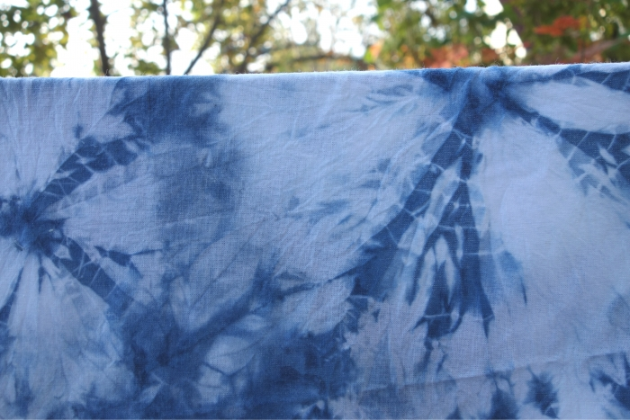 indigo dyed  cotton fabric with spiderweb pattern